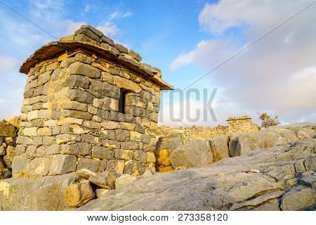 Stone shelter in an abandoned village in Hajar mountains of Ras Al Khaimah, UAE