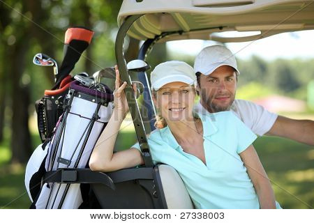 Couple in golf cart