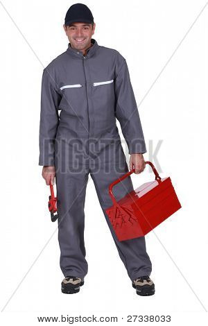 Plumber with wrench and tool box