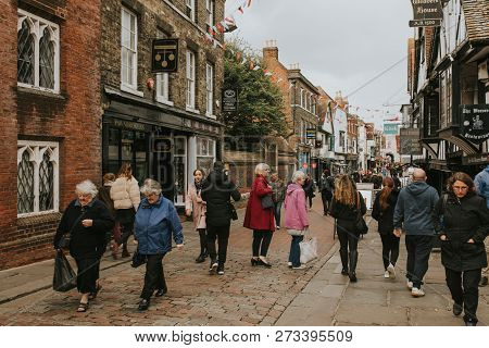 Canterbury, England - October 28th, 2018: A Crowd Walking Across A Shopping Street In Canterbury Vil