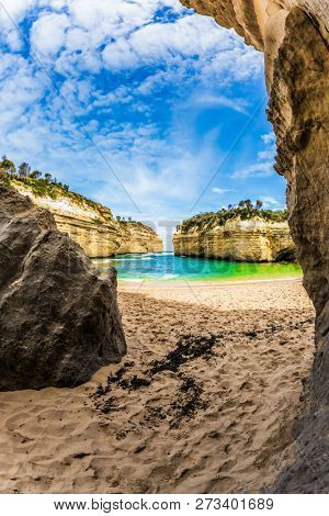 The concept of exotic, active and photo-tourism. Beautiful beach  in ocean fjord of Pacific ocean. The Great Ocean Road of Australia