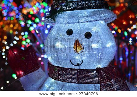 Christmas Concept With Snowman Lights At Night
