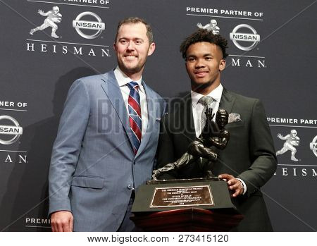 NEW YORK-DEC 8: Oklahoma Sooners quarterback Kyler Murray (R), winner of the 84th Heisman Trophy and head coach Lincoln Riley on December 8, 2018 at the Marriott Marquis in New York City.