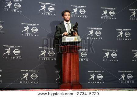 NEW YORK-DEC 8: Oklahoma Sooners quarterback Kyler Murray, winner of the 84th Heisman Trophy, poses with the trophy on December 8, 2018 at the Marriott Marquis in New York City.