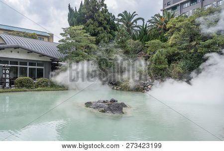 Beppu, Oita, Japan, November 8, 2018: Shiraike Jigoku (white Pond Hell) Pond In Autumn, Which Is One