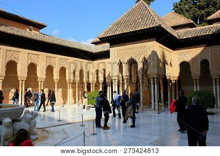 Granada, Spain - March 14: A Group Of Tourists In The Court Of Lions In The Alhambra Of Granada On M