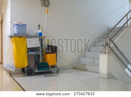 Cleaning Tools Cart Wait For Cleaner.bucket And Set Of Cleaning Equipment In The Apartment. Janitor