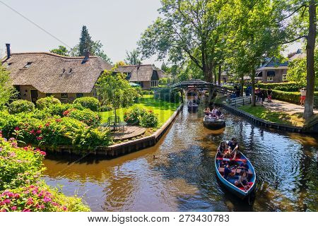 View Of Famous Village Giethoorn With Canals In The Netherland