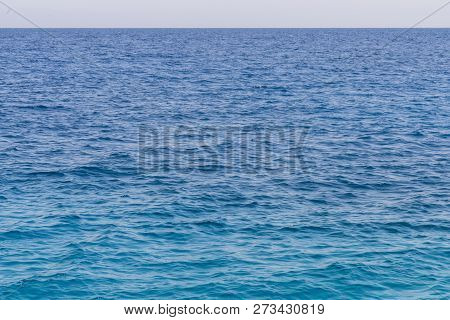 Blue Sea Background. Beautiful Sky And Blue Ocean Or Sea. Blue Sea Surface With Waves