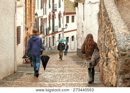 Granada, Spain - Nov 20: Narrow Streets With Many People Walking In Historical Part Of City On Novem