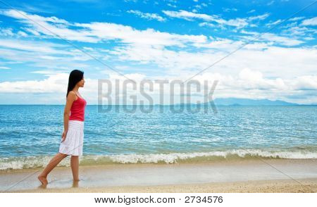 Red Dress Girl Strolling On The Beach