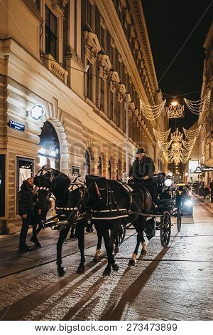 Vienna, Austria - November 24, 2018: Horse Carriage Tour On A Street In Vienna, Austria, In The Even