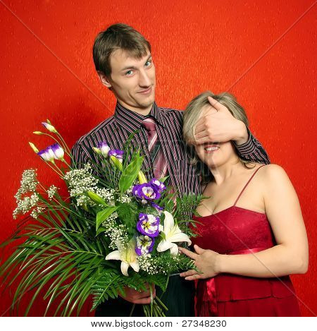 Man With a Flowers Covering Women's Eyes