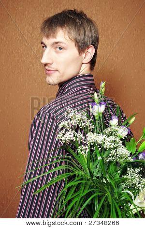 Man Hides Flowers