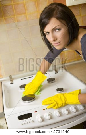Woman Cleaning The Stove