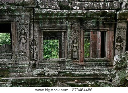 Looking Through Missing Windows On Ancient Stone Jungle Ruins In Cambodia