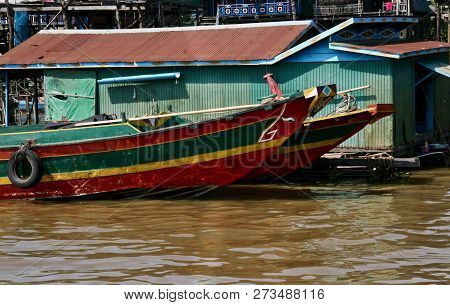 Colourful Long Wooden Boats At A Floating Village In Cambodia