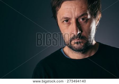 Portrait of pensive casual authentic man in his 40s, copy space included poster