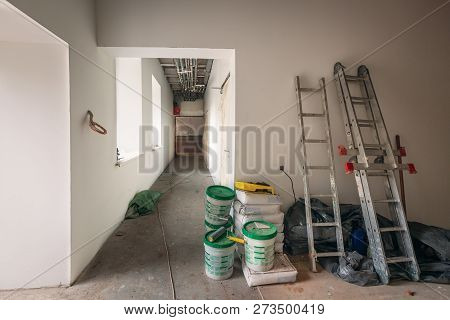 Construction Materials, Cans With Paint , Ladders And Bags With Cement, Claircole And Putty Are Stor