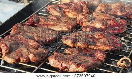 Steak Grilling On Fire. Process Of Cooking Meat. Steak On Barbecue. Preparation Of Appetizing Pork O