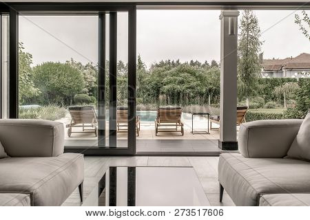 Modern Interior With Large Glass Door And Windows