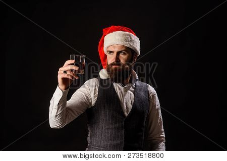 Handsome Rich Man With Stylish Mustache And Beard Hold Glass Of Brandy. New Year Party. Bearded Man