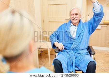Senior man doing occupational therapy in home nursing or nursing home
