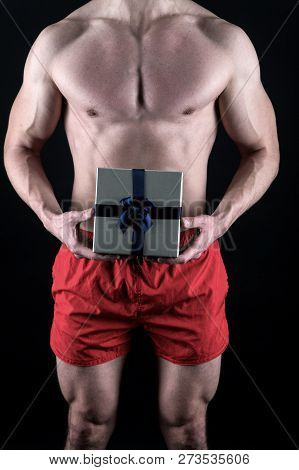 Sexy Surprise Concept. Macho Muscular Torso Posing With Gift Box. Santa Claus For Adult Girls. Sexy