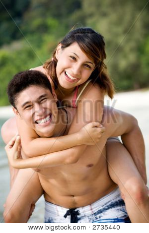 Couple By The Beach Having Fun