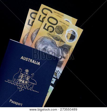 Australian Fifty Dollar Notes And An Australian Passport.