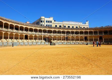 Ronda, Spain - March 10, 2015: Visitors To The Plaza De Toros Or Bullring. The Bullring At Ronda Is