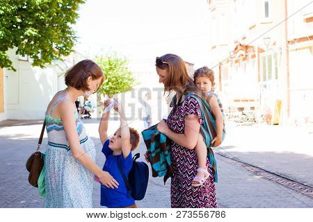 Mothers Spending Time Outdoors, Warm Summer Day