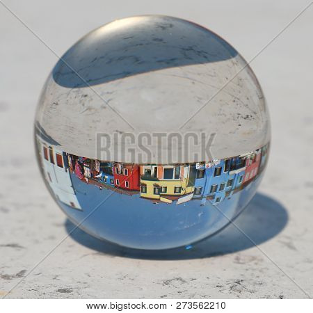 Large Crystal Ball Where The Colorful Houses Of The Island Of Burano Are Located Near Venice In Ital