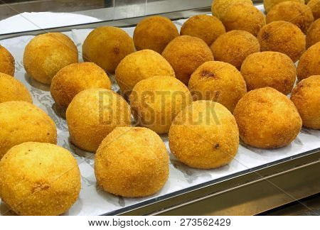 Typical Fried Sicilian Arancini Stuffed With Mozzarella And Tomato For Sale In A Shop Selling Typica