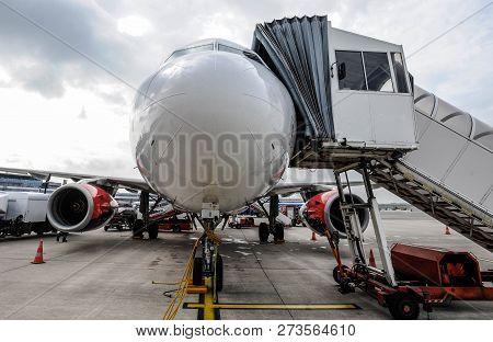Passenger Jet Standing On Tarmac Preparing For Departure