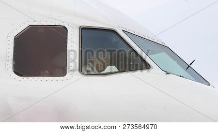 Hamburg, Germany - Circa June 2016: Air Serbia Airbus A320 Captain Pilot Standing On Tarmac Preparin