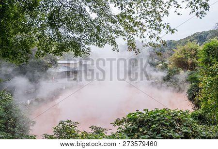 Beppu, Oita, Japan, November 8, 2018: Chinoike Jigoku (blood Pond Hell) Pond In Autumn, Which Is One