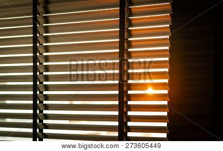 Opened Venetian Plastic Blinds With Sunlight In The Morning. White Plastic Window With Blinds. Inter