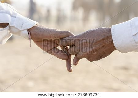 Couple Hands On The Street During Pushkar Camel Mela. Pushkar, Rajasthan, India, Close Up. In India,
