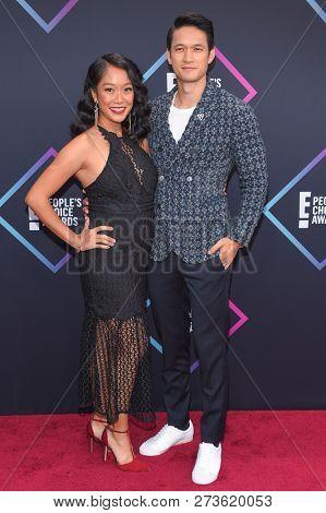 LOS ANGELES - NOV 11:  Harry Shum Jr. and Shelby Rabara arrives for the 2018 People's Choice Awards on November 11, 2018 in Santa Monica, CA