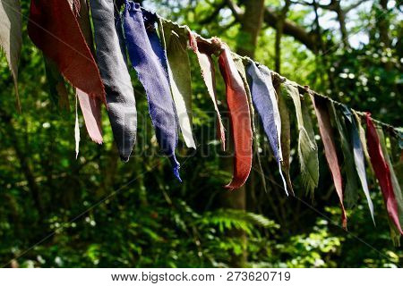 Small Coloured Prayer Flag Strips Tied Onto Rope Outside A Temple In Cambodia