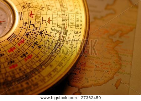 Chinese compass(Luo pan) over map of China.