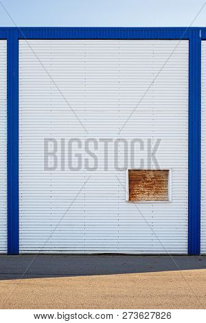 White Industrial Warehouse Wall In Blue Frame