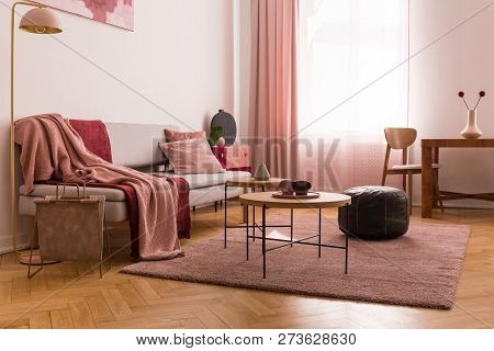 Pale pink living room interior in tenement house, real photo with copy space on the empty white wall and parquet on the floor poster