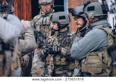 Kyiv, Ukraine - October 14, 2017: Group Of Men In Military Uniform With Body Armor And Weapons Durin