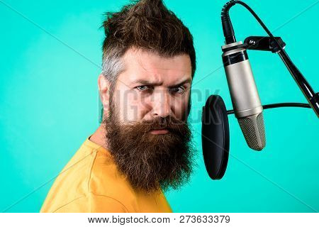 Brutal Bearded Singer With Microphone On Stage. Bearded Man Singing With Microphone. Concert&music C