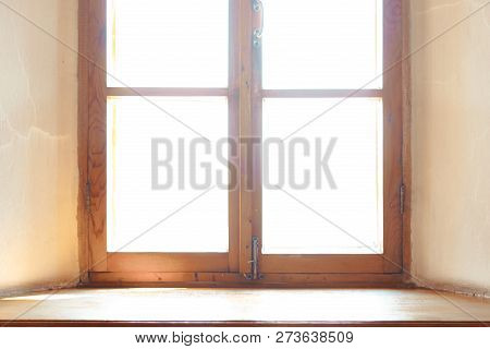 Wooden Window. Wide Wooden Window Sill. The Light In The Window