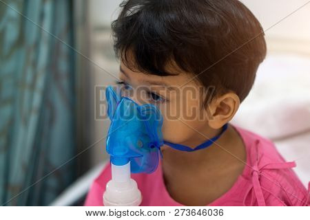 Asian kids boy 3 years old has Sick in nebulizer mask. poster