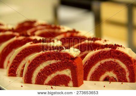 A Red Velvet Cake Roll Sliced On A Plate