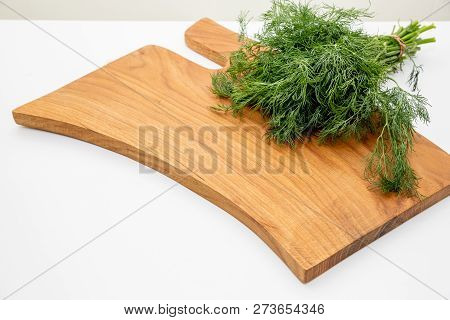 Fresh Garden Dill, Herbs On Wooden Boad. Top View With Copy Space.chopped Fresh Dill On A Cutting Bo
